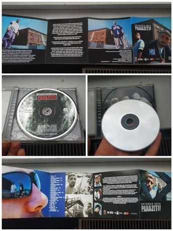 Cauti PARAZITII (colectie de 9 CD-uri), originale!? Vezi oferta pe coboramlaprima.ro